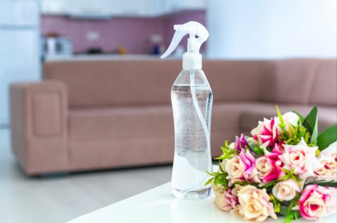 Air freshener on table for pleasant fresh floral smell in room at home